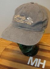 LADY COBRA WOMEN'S GOLF HAT GREEN WITH YELLOW EMBROIDERED LETTERING. ADJUSTABLE