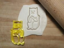 Cookie cutter cat raising middle fingers