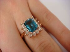 2.02 CT LONDON BLUE TOPAZ AND 0.60 CT T.W. DIAMONDS 14K ROSE GOLD RING 7.5 GRAMS