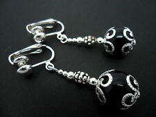 A PAIR OF DANGLY BLACK ONYX BEAD  SILVER PLATED DROP CLIP ON EARRINGS.
