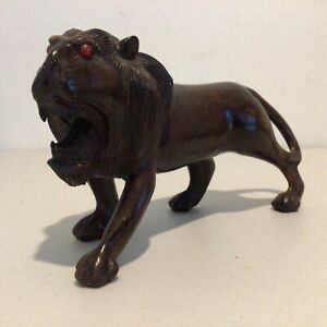 Vintage Wooden Lion Figurine with Red Bead Eyes. Approx. 25 x 9 cm #550