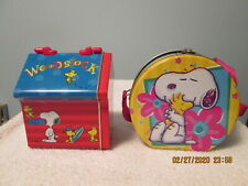 Lot of 2 Snoopy Peanuts Metal Tins Doghouse and Round with Strap
