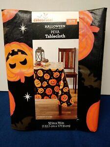 Celebrate Halloween PEVA Tablecloth 52X70 Inch Black with Orange Pumpkins