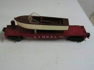 POST WAR LIONEL 6801 flat car with boat.  1957-60. Reproduction box.