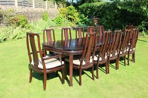 12 place extending table and chairs