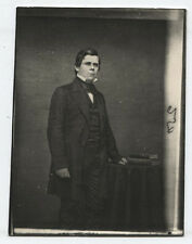 MESERVE CIVIL WAR COLLECTION MAN IN SUIT STANDING AT TABLE WITH BOOK.