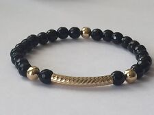 Black faceted Onyx And  Gold Filled Beaded Bracelet. Stretch
