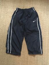 Boys Nike athletic pants black with white stripe and pockets size Xl