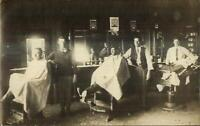 Barber Shop Interior Customers Barbers Chairs Signs c1910 Real Photo Postcard