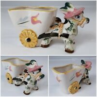 Donkey Burro Pulling Daisy Wheel Cart Planter in a Pink Hat Anthropomorphic