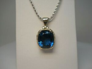 14KW Oval Blue Topaz Pendant and Necklace