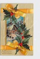 PPC POSTCARD MERRY CHRISTMAS SNOW COVERED BUILDING HOLLY YELLOW RIBBON EMBOSSED