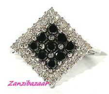 STRIKING 14K WHITE GOLD BLACK & WHITE DIAMOND RING