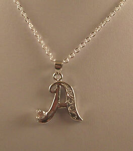 """Various A-Z Silver plated initial pendants and 18"""" chains."""