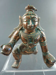 INDIAN COPPER ALLOY FIGURE OF SHIVA AS A CHILD WITH HIS BUTTER BALL