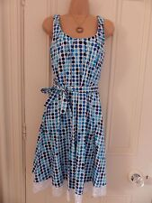 Beautiful white fitted Calvin Klein UK8 dress with blue dotty pattern, tie belt