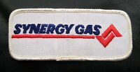 """SYNERGY GAS EMBROIDERED SEW OR IRON ON PATCH GAS OIL ADVERTISING 4"""" x 1 1/2"""""""