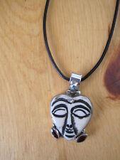 Carved Bone face, Sterling Pendant Garnets, Aquamarine