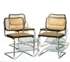 4 caned and chrome Marcel Breuer Dining Chairs.