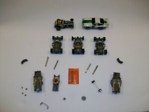 Lot of 5 Vintage Aurora AFX HO slot cars, 3- with green armatures - extra parts