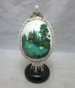 Hand painted egg figurine. Swans on a lake