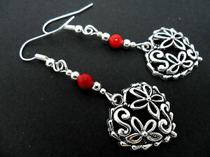 A PAIR OF  TIBETAN SILVER DANGLY HEART & RED CORAL BEAD EARRINGS. NEW.