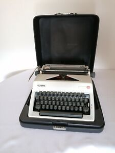 Vintage Typewriter Olympia Monica, with leather case Portable Working Manual
