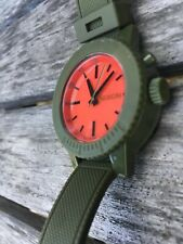 Women's Nixon Watch. The Go Go. Polycarbonate Case, Rubber Strap, Green, Red