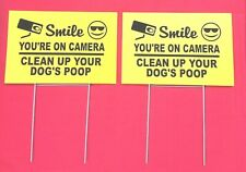 """New listing 2 signs 2 stands Smile You're On Camera clean up your dog's poop 12"""" x 8"""" signs"""
