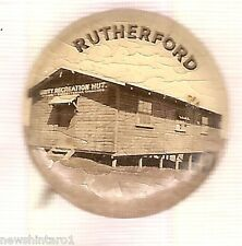 #D147. MILITARY TIN BADGE - RUTHERFORD RECREATION HUT