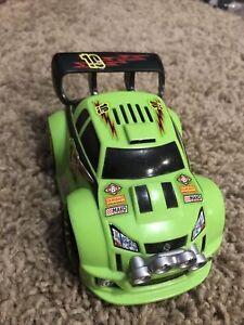 "2005 Fisher Price ""Shake & Go"" Green Goodyear Car"