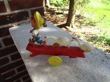VINTAGE GOOSE BOY PULL TOY RIEVO PRODUCT PLASTIC TOY MADE IN USA