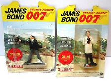 VINTAGE LOT OF TWO DR. NO & ODD JOB GILBERT TOYS ACTION FIGURES ON CARD AS IS