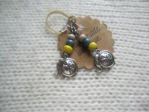 silver clover leaf elephant earrings with white/yellow/turquoise beads