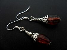 A PAIR OF BROWN OVAL CRACKLE GLASS EARRINGS WITH 925 SOLID SILVER HOOKS. NEW..