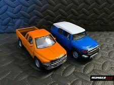 Kinsmart Orange Dodge RAM 1500 Pickup & Blue Toyota FJ Cruiser Pullback Trucks