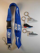 One Nike lanyard with three shoe keychains. Brand New! NCAA NBA NFL MLB Sport