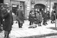 World War 2 Warsaw Poland-Child Lies in Ghetto Street-8x12  Photo