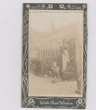 CDV WOMAN AT VILLAGE PUMP WITH DOG LOOKING ON