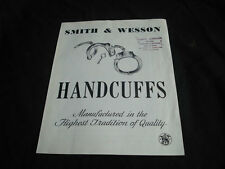 VINTAGE SMITH & WESSON HANDCUFFS ADVERTISEMENT