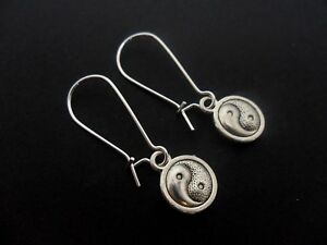 A PAIR OF YIN YANG EARRINGS ON SILVER PLATED KIDNEY EAR WIRES. NEW.