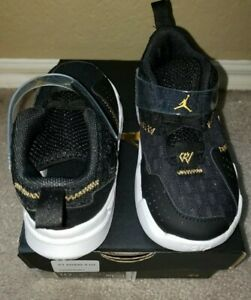 JORDAN WHY NOT ZERO.3(TD)Girl shoes size 10c Black metallic gold.