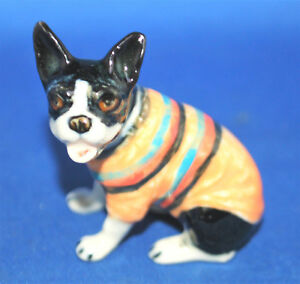A lovely vintage porcelain Boston Terrier in sweater seated dog figure