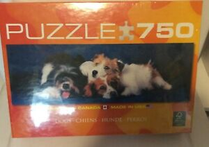 "Dogs 750 piece puzzle 12"" X 36"" New in Box"