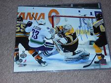 Bruins Timmy Thomas Autographed 16x20 Photo Hitting Sedin