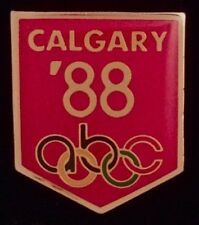 abc Olympic Media Pin Badge ~ 1988 ~ Calgary ~ Red ~ New in original packaging!!