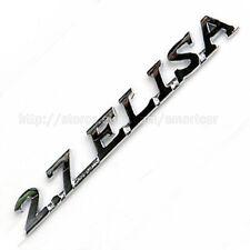 2001-2008 Hyundai Tiburon / Coupe OEM Tuscani + 2.7 ELISA emblem