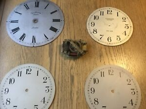 Synchronome slave clock dials, plus an early Synchronome slave movement