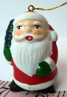 "Santa Claus with little Christmas Tree hanging Ornament 2"" tall"