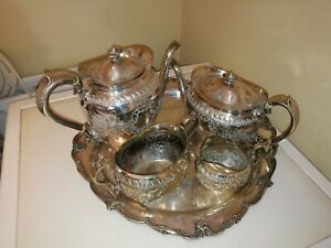 A Four Piece Silver Plated Tea Service with Unrelated Tray